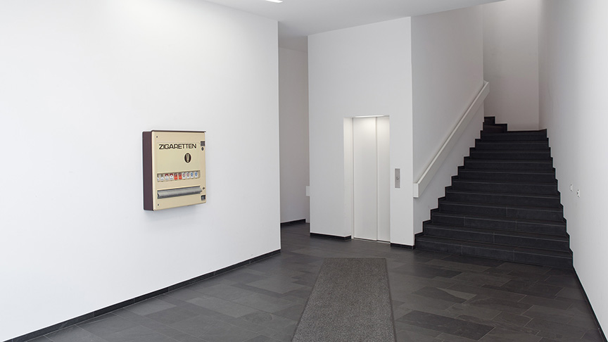 FAMED | Untitled [Wallwork #9], 2013, cigarette machine filled with smuggled cigarettes installation view L40, Berlin, 84 x 86 x 18 cm | photo: Ludger Paffrath